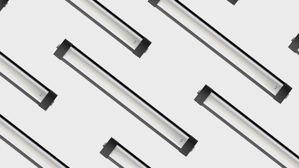 Varie lampade Lumin disposte su uno sfondo grigio